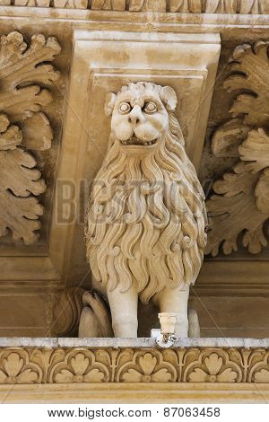 Lion Statue At The Santa Croce Baroque Church In Lecce