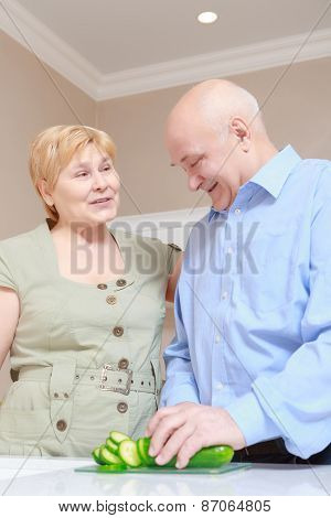 Elderly couple at home kitchen