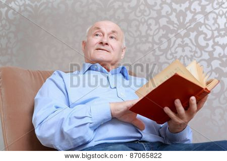 Man reads a book at home