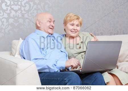 Couple with a laptop at home