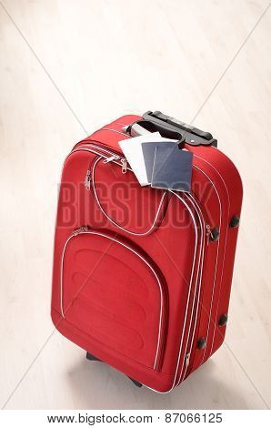 Suitcase And Passports