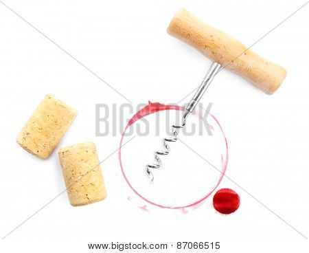 Wine stain, corks and corkscrew isolated on white