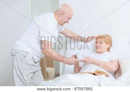 Man brings tea to his wife