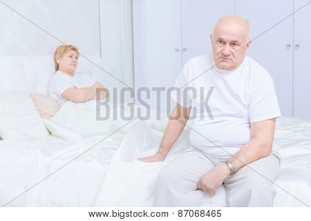 Man sitting on the bed