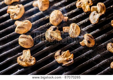 Champignon mushrooms grilled on BBQ