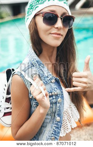 Woman In Sunglasses And Denim Vest Showing Hand Gesture Surfers