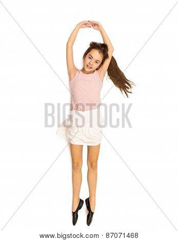 Isolated Shot Of Happy Cute Girl Lying On Floor And Dancing Ballet