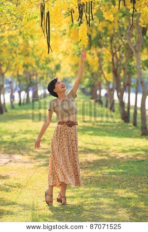 Portrait Of Beautiful Young Asian Woman Relaxing In Flowers Park Use For People Activities With Natu