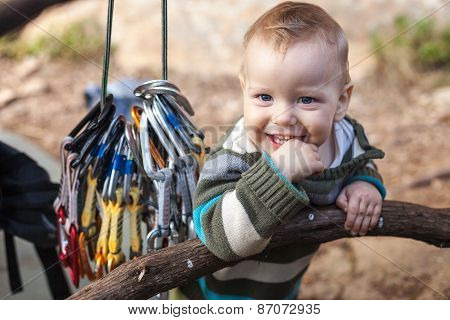 Child of rock climbers smiling while standing