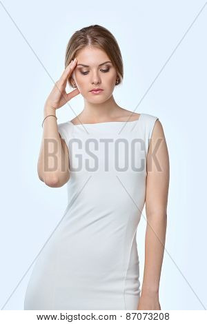 Woman with a headache holding head, isolated on white background