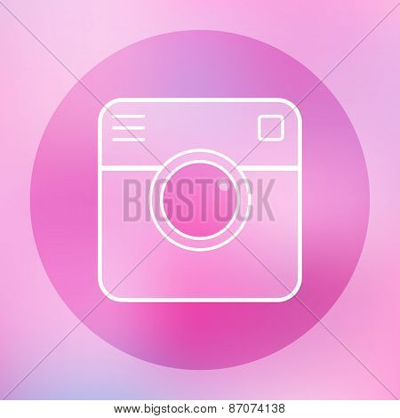 Camera icon on blurred background.