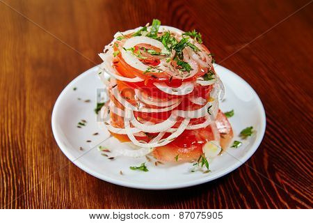 Uzbek National Salad Of Tomatoes, Onions, Herbs And Spices, Chopped Tomatoes And Sliced Onions Stack