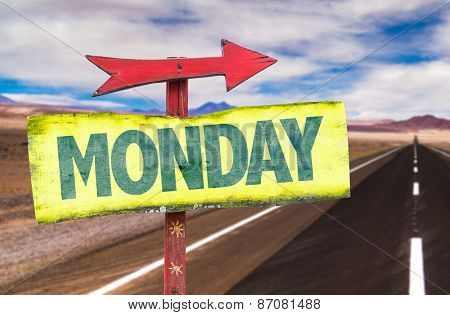 Monday sign with road background