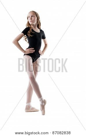Cute little ballerina warms up, isolated on white