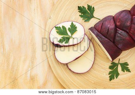 Treccia Braided Mozzarella Marinated In Red Wine On Wooden Cutting Board