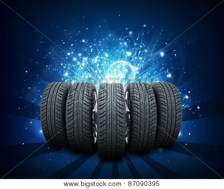 Wedge of new car wheels. Abstract blue background