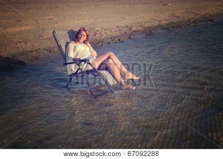 young woman in sexy swimsuit relaxing on the beach