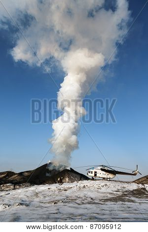 Eruption Tolbachik Volcano On Kamchatka, Helicopter And Tourists Near Smoking Volcano