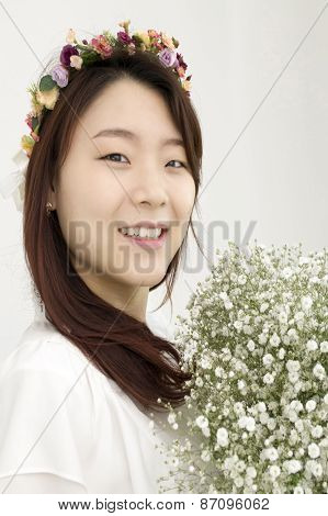 Beautiful asian bride with chaplet