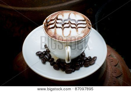 Latte Art, Coffee In Coffee Beans And Asian Pottery Background