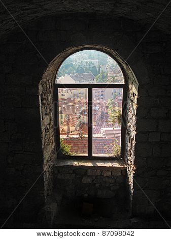 window and city roofs
