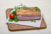foto of bacon  - Raw bacon with herbs and spices on wood - JPG