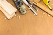 pic of chisel  - Carpenter plane chisels folding rule and wooden planks - JPG