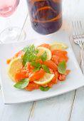 stock photo of redfish  - salad on salmon on the white plate - JPG