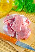 image of raw chicken sausage  - raw meat and knife on the kitchen table - JPG