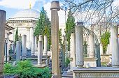 stock photo of mausoleum  - The medieval turkish cemetery and the Mausoleum of Sultan Mahmud II on the backgrond Istanbul Turkey - JPG