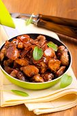 stock photo of soy sauce  - Chicken breast bits in soy sauce casserole - JPG