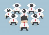 pic of observed  - businessman has been observed by eyeball head VECTOR EPS10 - JPG
