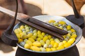 stock photo of cocoon  - Close up Yellow silk cocoons from Thailand - JPG