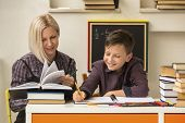 picture of tutor  - School tutor with young student - JPG