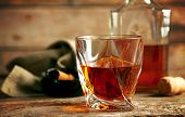 foto of whiskey  - Whiskey on wooden background - JPG
