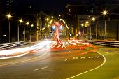 image of intersection  - Busy intersection at night with cars waiting for the stoplight to turn green - JPG
