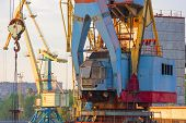 stock photo of loading dock  - crane for loading containers at the port - JPG