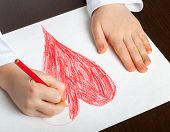 picture of drawing  - little boy draws with colored pencils drawing - JPG