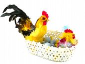 foto of pastel colors  - Colorful chickens in a basket with eggs in pastel colors as a Easter decoration over white - JPG