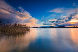 picture of landscapes beautiful  - Beautiful sunset over calm lake - JPG