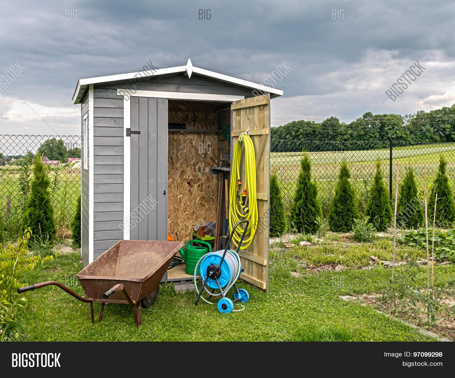 Wooden shed with different garden tools and equipment for Large garden equipment