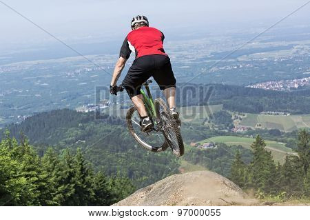 Mountain Bike Rider Jumping Precipice