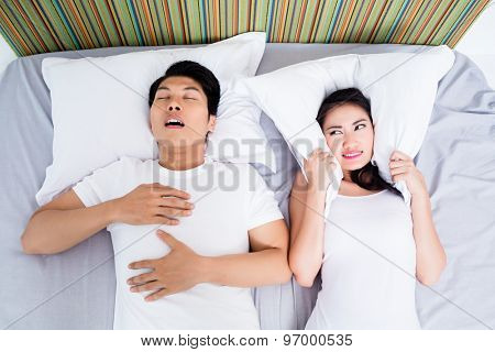 Chinese man snoring keeping his unhappy wife awake