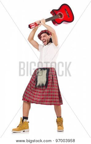 Man in scottish skirt holding guitar isolated on white