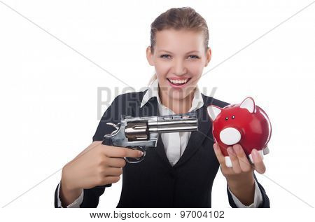 Business lady holding moneybox and gun isolated on white