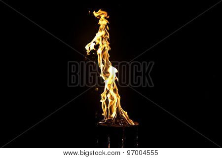 Image of bright yellow flame by night