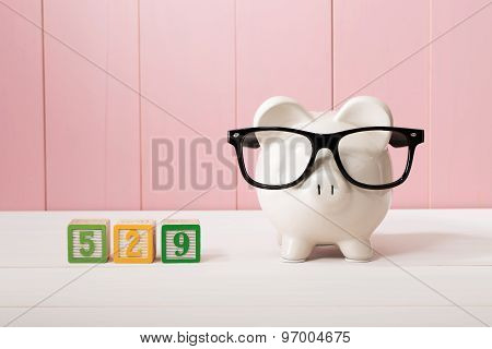529 College Savings Plan Theme With White Piggy Bank With Eyeglasses