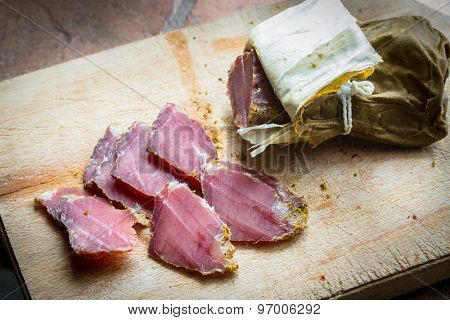 smoked wild boar meat on the wooden board