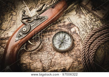 vintage  still life with compass,sextant and pistol