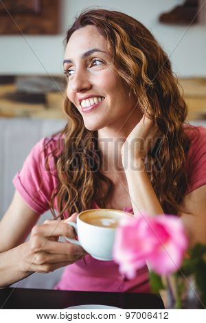 Young woman having a coffee at the cafe